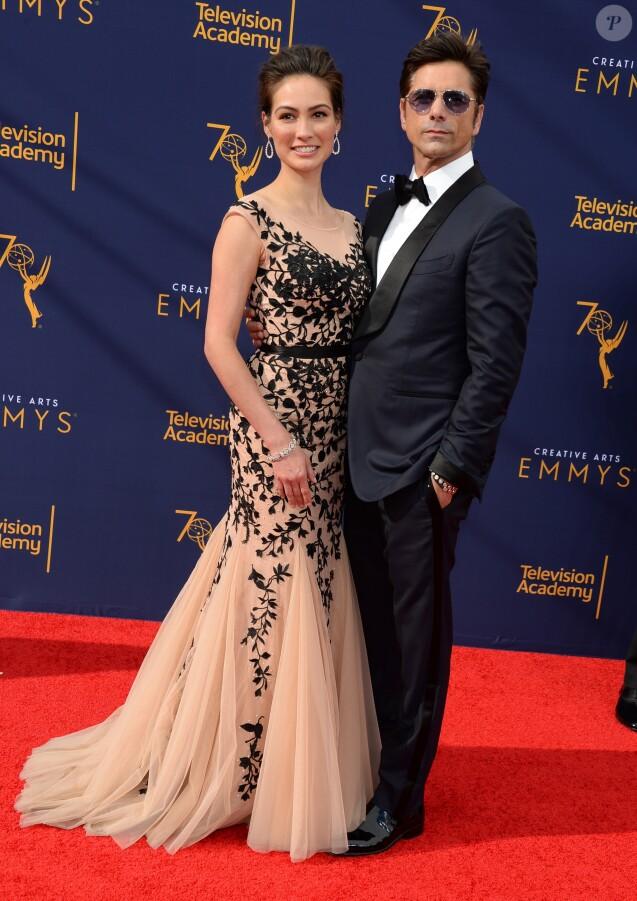 John Stamos et sa femme Caitlin McHugh lors de la soirée des Creative Arts Emmys Awards 2018 au Microsoft Theater à Los Angeles le 8 septembre 2018.