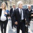 Bernard Tapie arrive au tribunal accompagné de ses avocats Hervé Témime et Julia Minkowski (femme de Benjamin Griveaux) à Paris le 1er avril 2019.