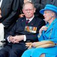 Le grand-duc Jean de Luxembourg, entouré de sa belle-fille la grande-duchesse Maria Teresa et de la reine Margrethe II de Danemark, le 6 juin 2014 à Ouistreham lors de la commémoration du 70e anniversaire du Débarquement, auquel il avait participé. Le grand-duc est mort dans la nuit du 22 au 23 avril 2019 à l'âge de 98 ans.