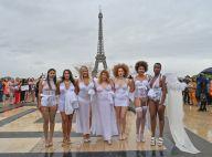 Des mannequins lingerie grande taille défilent au pied de la Tour Eiffel
