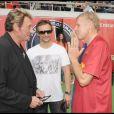 Johnny Hallyday, David et PPDA, lors du match de football en faveur de deux associations humanitaires (et de ses 66 ans), au Parc des Princes, le 14 juin 2009 !