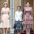 Les princesses Eugénie et Béatrice d'York lors de la garden party donnée à Buckingham Palace par la reine Elizabeth II le 29 mai 2019.