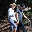 Exclusif - Kelly Rohrbach se promène main dans la main avec son nouveau compagnon l'héritier de Walmart Steuart Walton à Los Angeles le 20 mai 2017.