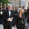 Eric Raoult et son épouse  à l'Elysée pour le dîner d'Etat du 22 juin.