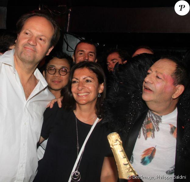 Exclusif - Jean-Marc Germain, sa femme Anne Higalgo (maire de Paris) et Jean-Luc Romero-Michel lors de la soirée d'anniversaire de J.L.Romero-Michel et A.Hidalgo au Banana Café à Paris, France, le 29 juin 2019. © Philippe Baldini/Bestimage