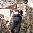 Ellen Pompeo va visiter sa prochaine maison.Bien enceinte, elle s'y rend en faisant un petit footing. 26/06/09