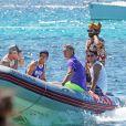 Lionel Messi, sa femme Antonella Roccuzzo, Luis Suarez, sa femme Daniella Semaan et Cesc Fabregas passent leurs vacances en famille à Formentera en Espagne le 29 juillet 2019.