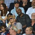 Vianney et sa chérie Catherine Robert, Harry Roselmack dans les tribunes lors du match de championnat de Ligue 1 Conforama opposant le Paris Saint-Germain au Toulouse FC au parc des Princes à Paris, France, le 25 août 2019. Le PSG a gagné 4-0. © Giancarlo Gorassini/Bestimage