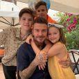 David Beckham et ses enfants Romeo, Cruz et Harper. Juin
