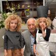 Exclusi - François Berléand avec ses jumelles Adèle et Lucie lors d'un goûter de Pâques 'Tout Chocolat' à l'Hôtel de Vendôme à Paris le 9 avril 2014.