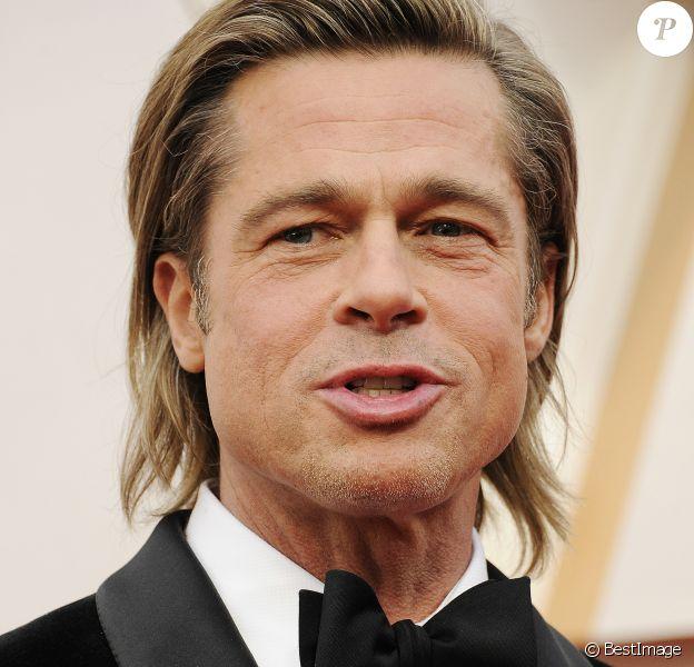 Brad Pitt lors du photocall des arrivées de la 92e cérémonie des Oscars 2019 au Dolby Theatre de Los Angeles. Le 9 février 2020.
