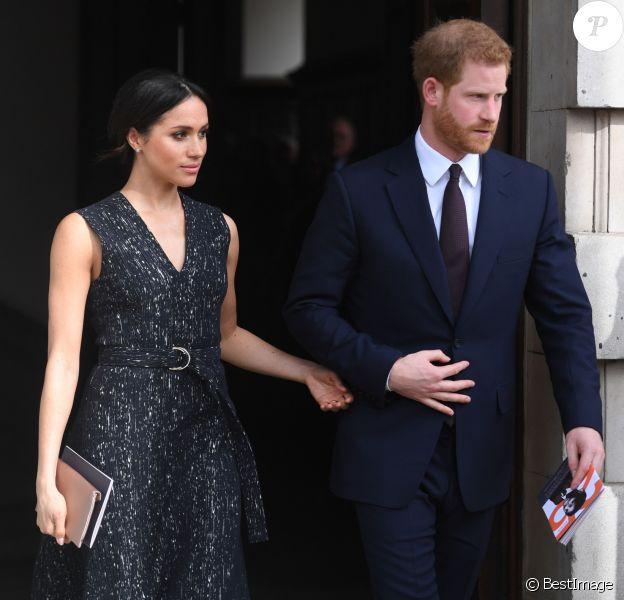 Meghan Markle et le prince Harry à la sortie de la cérémonie de commémoration du 25ème anniversaire de l'assassinat de Stephen Lawrence en l'église St Martin-in-the-Fields à Londres. Le 23 avril 2018