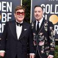 Elton John et son mari David Furnish - Photocall de la 77ème cérémonie annuelle des Golden Globe Awards au Beverly Hilton Hotel à Los Angeles, le 5 janvier 2020.