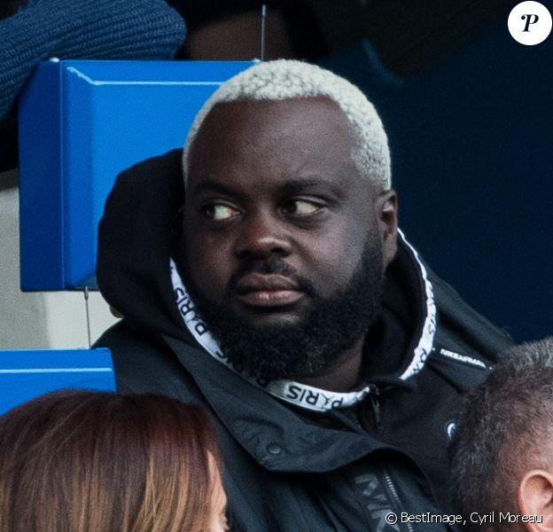 """Issa Doumbia dans les tribunes lors du match de Ligue 1 """"PSG - Angers (4-0)"""" au Parc des Princes à Paris, le 5 octobre 2019. © Cyril Moreau/Bestimage"""