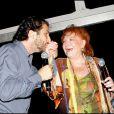 Régine et son ami Edouard Baer lors de la soirée des Vendanges du Désert, au domaine de Bertaud-Belieu, le 27 août 2009