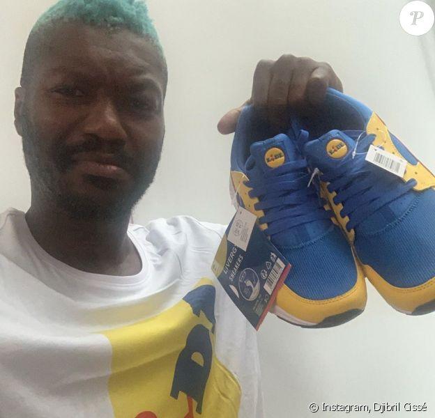 Djibril Cissé, heureux propriétaire des nouvelles baskets Lidl. Juillet 2020.