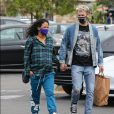 """Exclusif - Matt Pokora et sa femme Christina Milian, enceinte, sont allés déjeuner au """"Farmer's market"""" de Los Angeles, le 22 avril 2021. Le couple, déjà parents d'un garçon d'un an prénommé Isaiah, quittent les lieux main dans la main."""