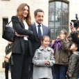 Nicolas Sarkozy et Carla Bruni ont voté au lycée La Fontaine à Paris (XVIe arrondissement) le 21 mars 2010 pour le second tour des élections régionales