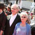 Ken Loach et sa femme sur le tapis rouge du festival de Cannes le 20 mai 2010
