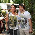 Christophe Dominici et son épouse à Roland Garros le 25 mai 2010 à Paris