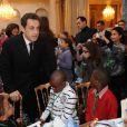 Nicolas Sarkozy et Carla Bruni lors du Noël de l'Elysée le 15 décembre 2010 au Palais présidentiel