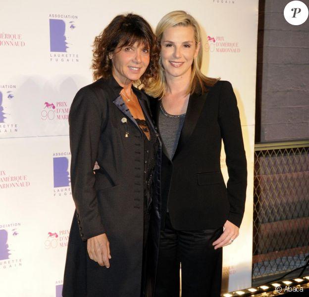 Laurence Ferrari et Stéphanie Fugain assistent au dîner de gala du 90e Prix d'Amérique, au Cent-Quatre (Paris XIe), samedi 29 janvier 2011.