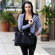 """Kim Kardashian et ses fameuses """"tresses africaines"""", en décembre 2010"""