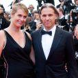 """Paul Belmondo et Luana remontent les marches du palais des festivals, lors du 64e festival de Cannes, à l'occasion de la projection du documentaire """"Belmondo, itinéraire..."""" Le 17 mai 2011"""