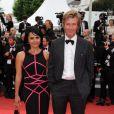 Philippe Caroit et une amie lors de la montée des marches du film La Conquête le 18 mai 2011 à l'occasion du 64e Festival de Cannes
