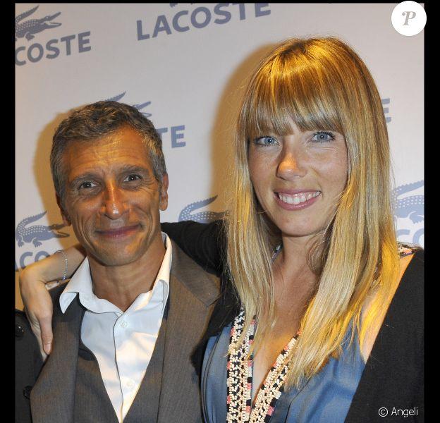 Nagui et sa femme Mélanie Page lors de l'inauguration de la nouvelle boutique Lacoste sur les Champs-Elysées en avril 2011