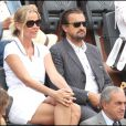 Henri Leconte et son épouse Florentine au tournoi de Roland-Garros, le lundi 30 mai 2011.