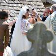 Lily Allen los de son union avec Sam Cooper le 11 juin 2011 en Angleterre a dévoilé son ventre arrondi de femme enceinte !