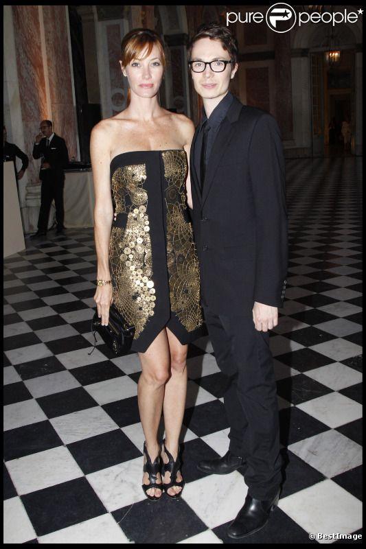 Mareva Galanter, délicieuse dans une or et noire, et Maxime Simoens lors de la soirée le 7 juillet 2011 au Grand Trianon