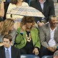 Aretha Franklin a assisté à la victoire de Roger Federer sur Jo-Wilfried Tsonga sous la pluie le 8 septembre 2011 lors de l'US Open 2011