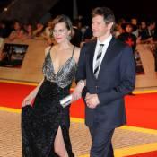 Milla Jovovich : Une diva très décolletée au bras de son mari