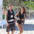 Tom Felton et Jade en vacances à Miami, le 1er janvier 2012. En route pour le jet ski...