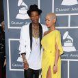 Amber Rose et Wiz Khalifa sur le tapis rouge de la cérémonie des 54e Grammy Awards au Staples Center de Los Angeles le 12 février 2012. Les stars étaient nombreuses à être venues accompagnées pour la grand-messe des récompenses musicales américaines.