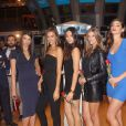 Crystal Renn, Irina Shayk, Jessica Gomes, Nina Agdal et Michelle Vawer font le bonheur des agents du NYSE à New York, le 14 février 2012.