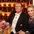Sir Roger Moore et son épouse Kristina Thorstrup au 56e Bal de l'Opéra de Vienne.   Comme chaque année, de nombreuses célébrités et personnalités ont assisté en toute élégance au 56e Bal de l'Opéra de Vienne, le 16 février 2012.