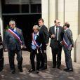 Patrick et Isabelle Balkany assistaient aux obsèques d'Olivier Rey, mort le 19 mars 2012 à 56 ans, célébrées le 24 mars en l'église Saint-Justin de Levallois-Perret (Hauts-de-Seine), en présence de personnalités du sport et des médias.
