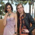 Melissa Mars et Christophe Guillarmé posent devant le Majestic Barrière lors du Cannes Shopping Festival. Le 7 avril 2012.