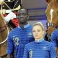 Mamadou Sakho et Laure Boulleau présentent le nouveaux maillot de l'équipe de France au manège du quartier des Célestins de la Garde Républicaine à Paris le 16 avril 2012