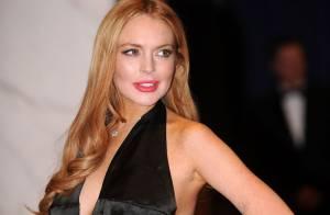 Lindsay Lohan sexy face à de nouvelles rumeurs devant une Kim Kardashian sage