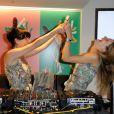 Aux platines, Lio et sa fille Nubia s'éclatent comme des folles lors de la soirée Mikado King Choco chez Colette à Paris le 24 mai 2012