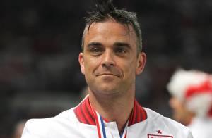 Robbie Williams : Champion engagé durant une soirée ternie par un accident