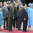 Cérémonie de bienvenue pour la visite officielle du président de la République populaire de Chine Hu Jintao et son épouse Liu Yongqing sur le tarmac de l'aéroport Kastrup de Copenhague, le 14 juin 2012.