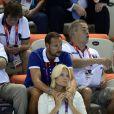 Le prince héritier Haakon de Norvège et la princesse Mette-Marit à la piscine olympiques lors des JO de Londres, le 28 juillet 2012.