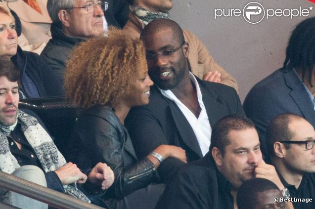 Teddy Riner et sa compagne Luthna lors du match du Paris Saint-Germain face à Toulouse (2-0) le 14 septembre 2012 à Paris
