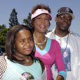 Whitney Houston avec son ex-mari Bobby Brown et leur fille Bobbi Kristina à Anaheim, le 7 août 2004.