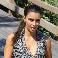 Kim Kardashian, ravissante et en balade sur la plage. Miami, le 3 octobre 2012.
